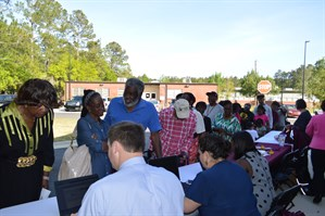 Photo from last year's community event with Rep Anderson - image of constituents lined up to check to see if they have unclaimed property